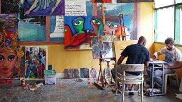 Ben Quilty (right) teaching Myuran Sukumaran to paint in Bali's Kerobokan prison.