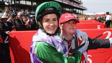 Michelle Payne celebrates her winning ride on Prince Of Penzance to win race 7 the Emirates Melbourne Cup.
