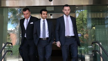Dr Shammi Kabir (middle) leaves Glebe Coroner's Court, accompanied by barrister Robert Sutherland SC and solicitor Nick Hanna.