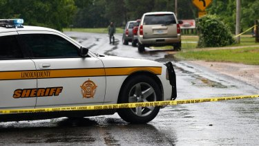 Lincoln County police at the scene of one of the shootings in Brookhaven, Mississippi.