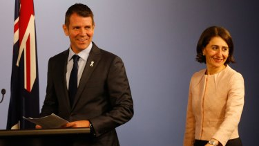 All smiles: NSW Premier Mike Baird and Treasurer Gladys Berejiklian last month. The budget half-yearly review detailing the budget windfall is expected to released on Thursday.