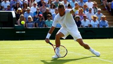 Wimbledon farewell: Lleyton Hewitt of Australia bows out against Jarkko Nieminen of Finland.