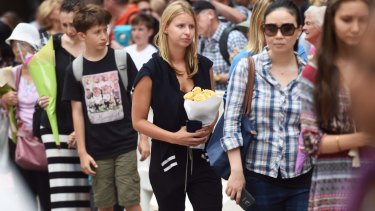 Madeleine Pulver queues up to pay tribute at Martin Place on Thursday.
