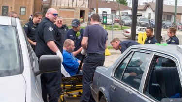 Dayton police and paramedics revive a man who has overdosed.