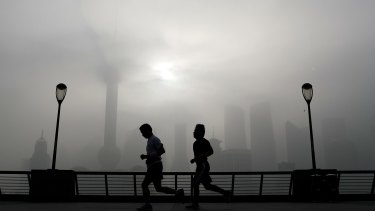 Joggers along Shanghai's famous Bund: China's pollution is on the rise.