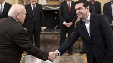 Anti-austerity leader: Greece's Prime Minister Alexis Tsipras, right, shakes hands with Greek President Karolos Papoulias at the Presidential Palace.