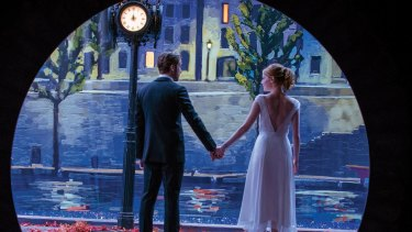 Sebastian (Ryan Gosling) and Mia (Emma Stone) light up the screen in <i>La La Land</i>.