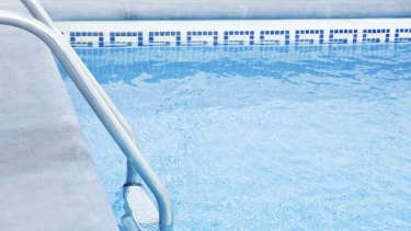 The death of a woman in a Gold Coast swimming pool is not being considered suspicious.