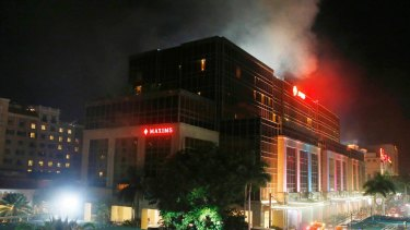 Smoke rises from the Resorts World Manila complex near Manila, Philippines.