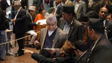 Nepalese Prime Minister Khadga Prasad Oli, centre, prepares to cast his vote as legislators vote for a new president in Kathmandu, Nepal, on Wednesday.