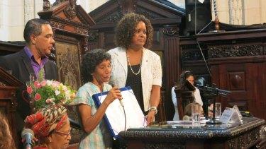 Maria da Penha Macena, centre, received an award from the Rio de Janeiro legislative assembly.