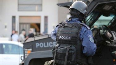 Police conduct a raid in Lockwood Street, Merrylands.