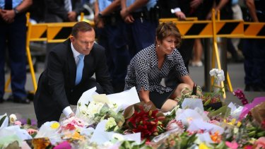 Prime Minister Tony Abbott and wife Margie left flowers at the makeshift memorial at Martin Place.