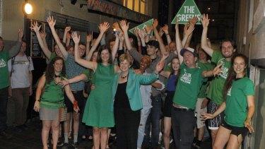 Ellen Sandell celebrates with supporters after winning Melbourne in 2014.
