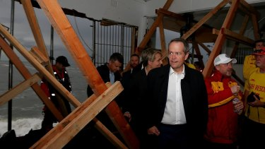 Opposition Leader Bill Shorten tours the storm affected Coogee Surf Life Saving Club in Sydney on Tuesday.