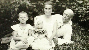 Yelena as a baby with her parents and older sister Dina in the northern summer of 1935.