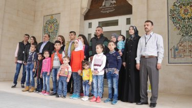 The first four refugee families given visas for resettlement in Australia earlier this month, pictured in Jordan.