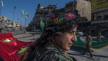 Fighters from the Women's Protection Units hold a celebration in Paradise Square in Raqqa, Syria. The Kurdish female militia took part in freeing the city from Islamic State.