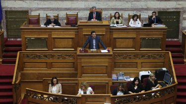 Greek Prime Minister Alexis Tsipras delivers his speech as he attends a parliamentary session in Athens.
