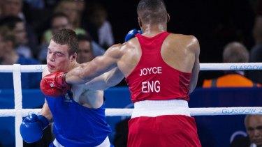 Outboxed: Joe Joyce of England pins Joe Goodall of Australia.