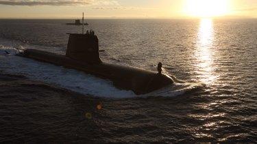 Australian Navy submarines, the  HMAS Dechaineux and HMAS Waller, on exercise.