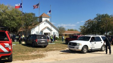 Emergency personnel respond to a fatal shooting at a Baptist church in Sutherland Springs, Texas.