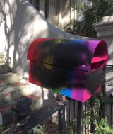 The same-sex letterbox, covered in black paint after the first instance of vandalism.