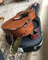 Perth musician Riley Pearce's guitar was smashed on a Qantas flight to London.