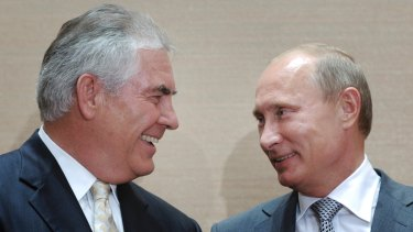 Picture from happier times: Exxon Mobil's chief executive, Rex Tillerson, with Russian President Vladimir Putin.