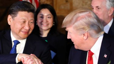 President Donald Trump, right, shakes hands with Chinese President Xi Jinping during a dinner at Mar-a-Lago.