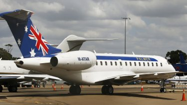 Clive Palmer's private jet sits at the Mascot private terminal in Sydney on Thursday.