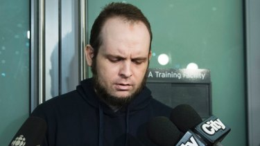 Joshua Boyle speaks to the media after arriving at the Pearson International Airport in Toronto.