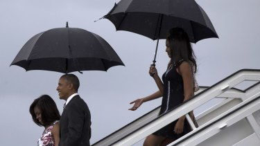 President Barack Obama, arrives with first lady Michelle Obama, left, and their daughters Sasha, front right, and Malia.