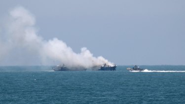 Smokes rises from the Egyptian Navy vessel on the coast of northern Sinai.