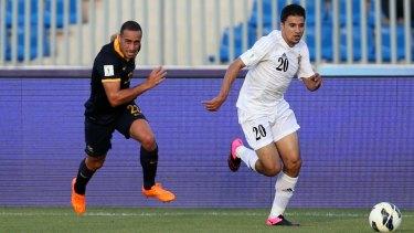 Giving chase: Tarek Elrich pursues Hamza Aldaradreh during the Socceroos' 2-0 loss to Jordan.