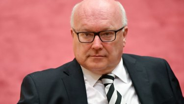 "MPs who can ""honestly swear"" they didn't know they were dual citizens should be ruled eligible, George Brandis told the High Court."
