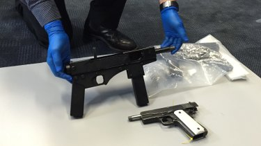 "Police found ""uzi-style"" submachine guns and handguns on the Gold Coast on Friday."