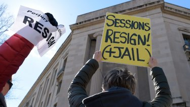 Protesters gather outside the Justice Department in Washington