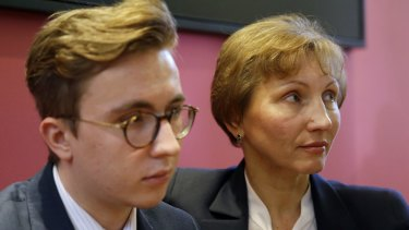 Marina Litvinenko, widow of former Russian spy Alexander Litvinenko, places her arm around son Anatoly during a press conference in London.