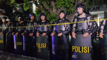 Riot police gather outside Kerobokan prison for the transfer.