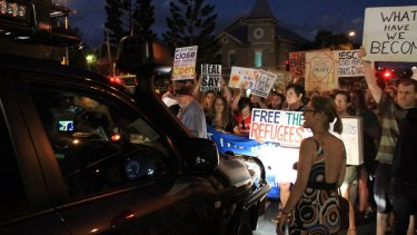 Protesters stop police cars to look for Baby Asha.