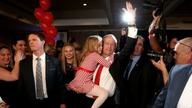 Opposition leader Bill Shorten with daughter Clementine depart Labor's election night function on Saturday night.