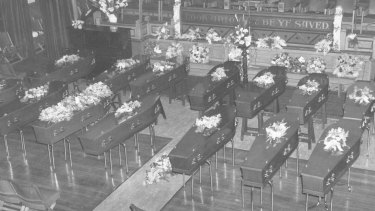 Coffins of 15 unclaimed bodies from the fire, laid out in the Salvation Army's City Temple in Bourke Street, August 23, 1966.