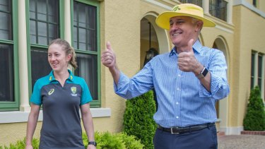 Malcolm Turnbull celebrates with the Australian women's cricket team on Wednesday after their Ashes win.
