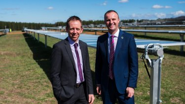 ACT Greens and Labor leaders Shane Rattenbury and Andrew Barr at a Canberra solar far. The two parties have worked together for much of the past decade, backing largely popular policies.