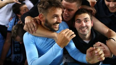 Happy days: Milos Ninkovic of Sydney FC celebrates with fans after the derby win against the Wanderers.
