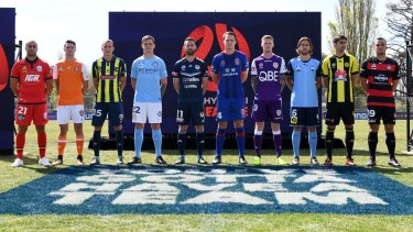 Two to be added: Players from the existing 10 teams line up for this season's launch.
