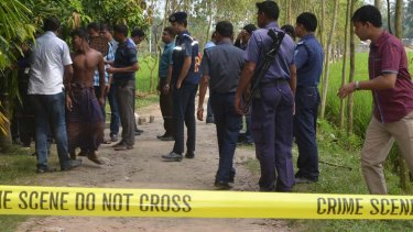 Security officers at the Rangpur site where a Japanese man, Kunio Hoshi, was shot dead on Saturday.