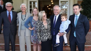 Prime Minister Malcolm Turnbull with his grandson Jack, wife Lucy, his daughter Daisy, son in law James Brown and parents-in-law Tom and Christine Hughes at Government House following his swearing in.