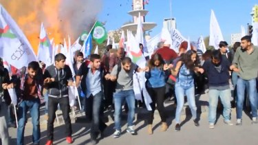 Participants in the October 10 peace rally in Ankara react at the moment of the first explosion. Islamic State has been blamed for the attack on the rally, made up largely of leftists and HDP activists.
